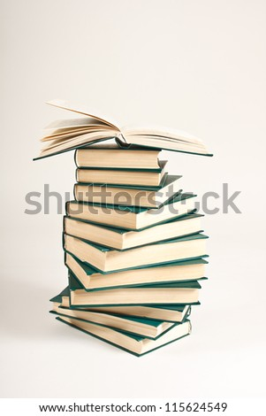 Pile of books on white background