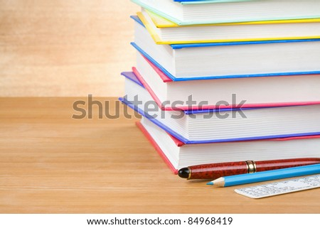 pile of books on wood background - stock photo