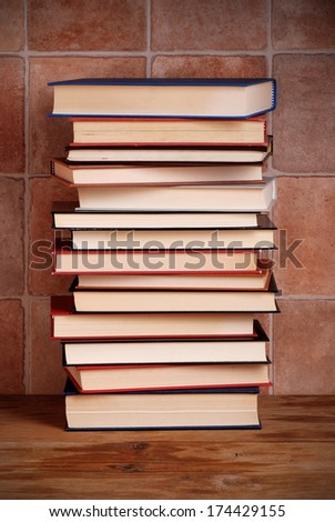 pile of books on wooden table