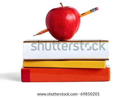 Pile of books, pencil, and an apple representing education or school. - stock photo