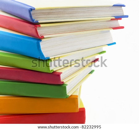 Pile of books with bright covers on white background - stock photo