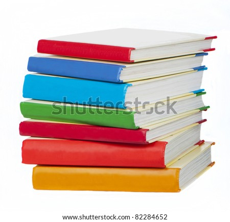 Pile of books with bright covers on white background