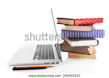 Pile of books with laptop isolated on white