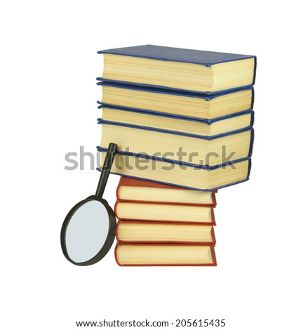 Pile of books with magnifying glass. Isolated on white background - stock photo