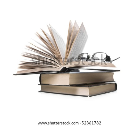 pile of books with one book open and eyeglasses  on white background - stock photo