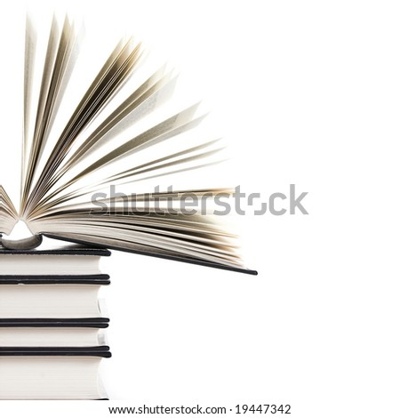 pile of books with one book open on white background - stock photo