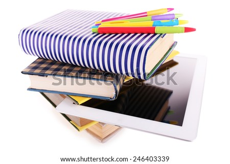 Pile of books with tablet isolated on white - stock photo