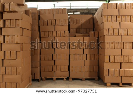 pile of box, stored in a warehouse - stock photo