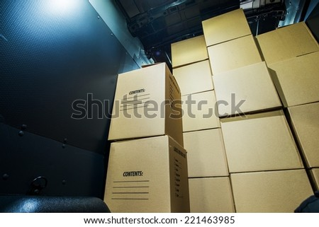 Pile of Boxes in a Cargo Van Closeup. Products Transportation Industry. Shipping and Delivery. - stock photo