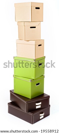 pile of boxes in different colors isolated on white - stock photo