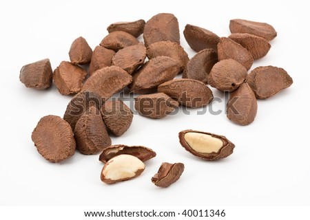 Pile of brazil nuts over white background - stock photo