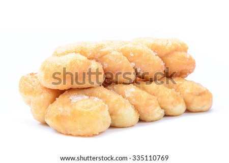 Pile of breads twists donut, isolated on white background