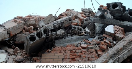 Pile of bricks and debris from destroyed building - stock photo
