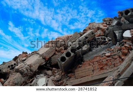 Pile of bricks and debris from destroyed building. - stock photo