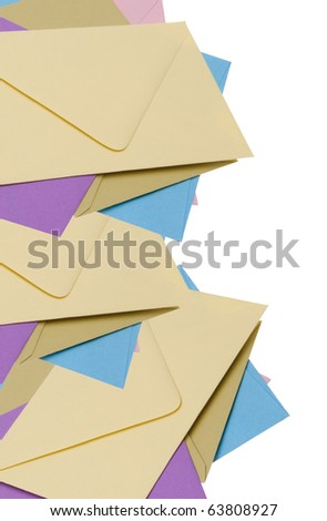 Pile of bright envelopes, fun stationery Border!  Isolated on white with a clipping path. - stock photo
