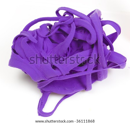 Pile of bright purple clay.  Isolated against a white background. - stock photo