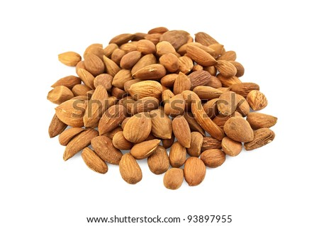 Pile of brown almonds isolated on white background