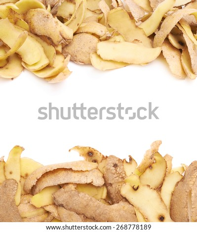 Pile of brown potato peels isolated over the white as a  copyspace background composition - stock photo