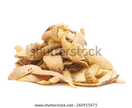 Pile of brown potato peels isolated over the white background - stock photo
