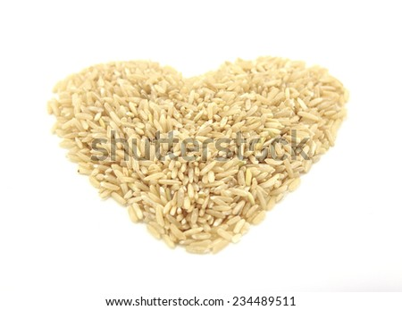 pile of brown rice isolated on white