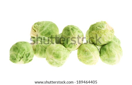 Pile of brussels sprouts isolated over the white background - stock photo