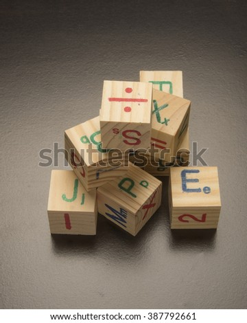 Pile of building wooden blocks/Educational Tool/Children learning toy being used to teach - stock photo