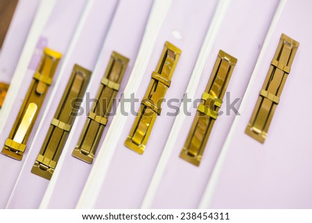 Pile of business paper file in golden clips - stock photo