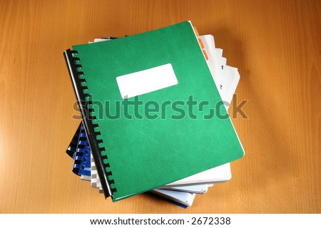 Pile of business reports - stock photo