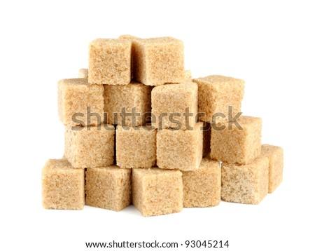 Pile of cane sugar cubes isolated on white background - stock photo