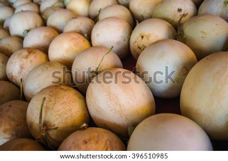 pile of cantaloupe fruit for sale