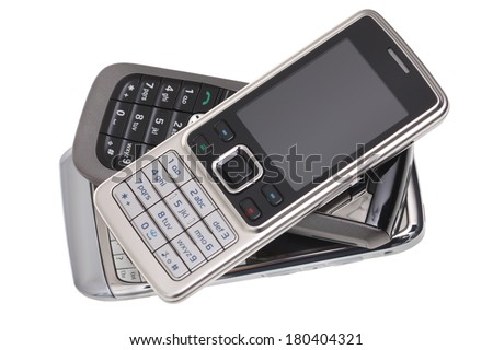 Pile of cell phones, cut out on white background