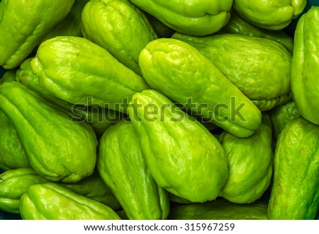 Pile of chayote fruits - stock photo