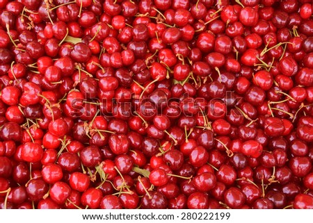 Pile of cherries fresh fruit background texture. - stock photo