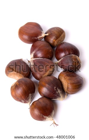 Pile of chestnut fruit isolated on white background - stock photo