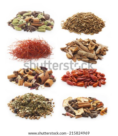 pile of chili peppers, cumin and cinnamon, hot wine and venison seasoning on white background.  - stock photo