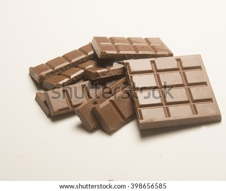 Pile of Chocolate/Chocolate Candy/Split chocolate bar for eating - stock photo