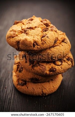 Pile of chocolate cookies on wooden table - stock photo