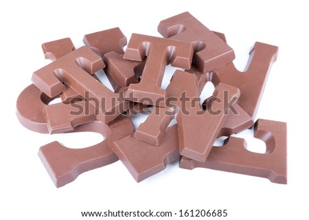 Pile of chocolate letters for Dutch event Sinterklaas in december - stock photo