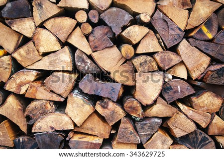 Pile of chopped fire wood prepared for winter, wood textures. - stock photo
