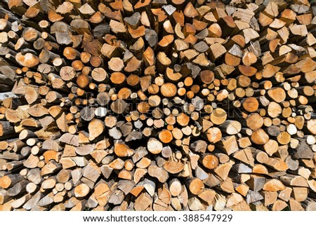 Pile of Chopped Firewood / Background of dry chopped firewood logs in a pile - stock photo