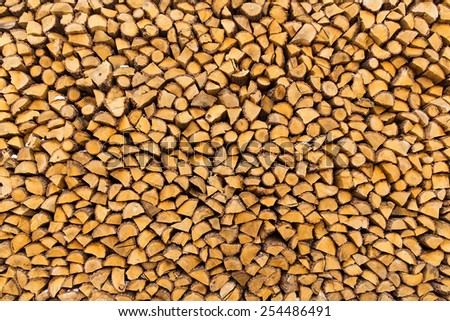 Pile of chopped firewoods - stock photo