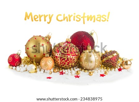 Pile of christmas  balls in gold  and red colors  on snow  isolated on white background - stock photo