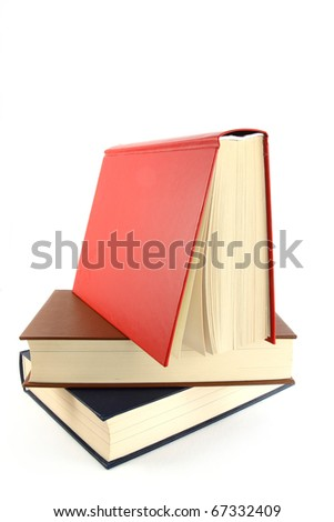 Pile of closed and open books - stock photo