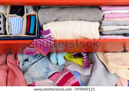 Pile of clothes in open drawer, close up - stock photo