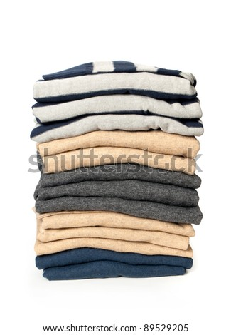 pile of clothes on a white background - stock photo