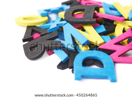 Pile of cmyk painted wooden letters isolated over the white background - stock photo