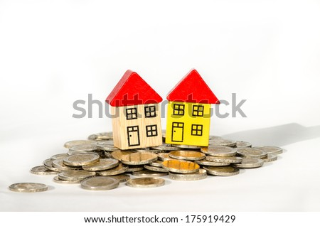 pile of coins and house detail image - stock photo