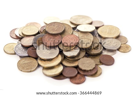 Pile of coins growing on white background
