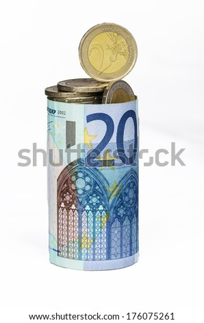 pile of coins in bank note - stock photo