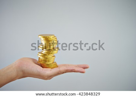 Pile of coins on hand